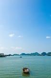 Cat Ba Bay. Small boat left alone at Cat Ba bay royalty free stock photo