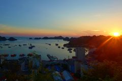Cat Ba Island panorama overlooking port and fishing boats with a colorful sunset, Ha Long bay, Vietnam royalty free stock images