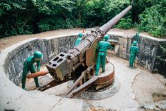Soldier and cannon at Cannon Fort in Cat Ba, Vietnam. Cat Ba, Vietnam - October 18, 2018 : Soldier and cannon at Cannon Fort stock images