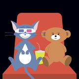 Cat and bear at the cinema. Cat with bear sitting on the chair at the movie theatre Royalty Free Stock Photo
