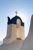 Cat and Bell Tower with cross at Oia, Santorini, Greece Royalty Free Stock Photos