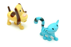 Cat and bog. Toys -dog runs after the cat Royalty Free Stock Photos