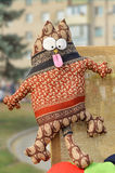 Cat with bulging eyes and protruding tongue. Rag toy souvenir Stock Photography