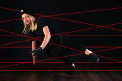 Cat burglar negotiating laser beam alarm system Stock Images