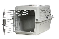 Cat Carrier. A grey cat carrier with the door open, isolated against a white background Stock Images