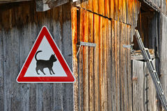 Cat caution signpost on barn Royalty Free Stock Image