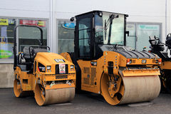 Cat CB22B and CB44B Paving Equipment on Asphalt Yard Royalty Free Stock Photo