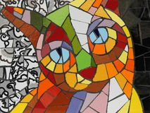 Cat in ceramic mosaic, made with pieces of tile. stock photo