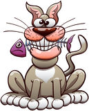 Cat Chewing domestique heureuse un poisson Images stock