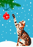 Cat with Christmas tree decoration. Cat sitting in snow raises a paw towards a red globe decoration on a Christmas tree, background of blue sky and snowflakes Vector Illustration