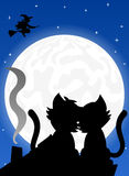 Cat couple on a roof at full moon Royalty Free Stock Photos