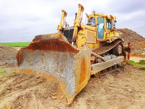 The Cat D9T Dozer. The Cat D9T Dozer is a highly versatile machine flexible enough to be used in heavy construction, quarries, landfills, forestry, and mine royalty free stock image
