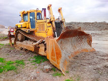 The Cat D9T Dozer. The Cat D9T Dozer is a highly versatile machine flexible enough to be used in heavy construction, quarries, landfills, forestry, and mine royalty free stock images