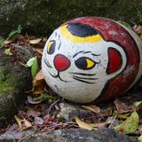 Cat decoration. Onomichi, Japan - town in the region of Chugoku. Stone painted as cat - there are many similar traditional decorations in Onomichi stock photo