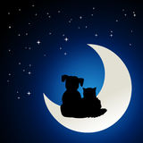 Cat and dog friendship. Animal friendship concept - Illustration of small cat and dog black silhouettes sitting together on the moon, watching the blue sky with Royalty Free Stock Image