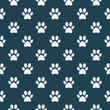 Cat of dog paw pattern. Vector seamless texture made with white paws on blue background royalty free illustration