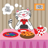 Cat drinking hot tea with sweets and dryers Royalty Free Stock Image