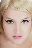 Cat eyes. Close-up portrait of beautiful blond young girl with trendy makeup Royalty Free Stock Photography