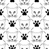 Cat face and paw seamless pattern stock photo