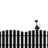 Cat on the fence silhouette Stock Photos