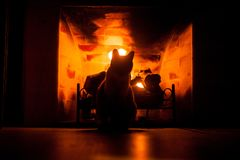 Cat in fireplace. A cat silhouette in a fireplace Stock Images