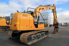 Cat 318FL Hydraulic Excavator on a Yard Stock Photo