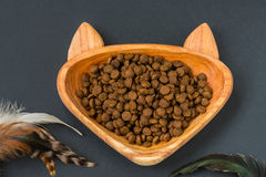Cat food in bowl - shape of a cat and toy teaser Stock Photo