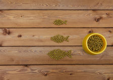 Cat food in bowl  on wood background looks like  fish. Cat food in bowl and on wood background looks like a fish Stock Photo