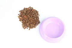 Cat food out of a purple pink bowl with water isolated on white background Stock Photo