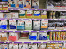 Cat food products on store shelf. Multiple shelves of cat food product in a pet store Stock Photo