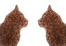 Cat food shape. Silhouettes of head cats made from cat food stock images