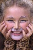 Cat girl. Smiling girl with cat make-up Royalty Free Stock Photo