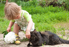 Cat and girl in garden Royalty Free Stock Photo