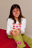 Cat-girl. Smiling girl with a face paint of a cat royalty free stock photos