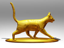 Cat. Golden figurine of a cat move forward Stock Photos
