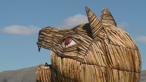 Cat-headed craft on a reed boat, Uros Island, Peru