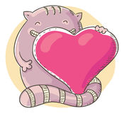Cat holding a big heart Royalty Free Stock Image