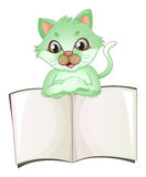 A cat holding an empty book Stock Photography