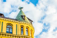Cat House Kaķu nams for two cat sculptures, with arched backs and raised tails, on its roof building in old town of Riga, Latvia. Cat House KaÄ·u nams royalty free stock photos