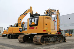 Cat Hydraulic Excavators on a Yard Royalty Free Stock Images
