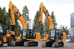 Cat Hydraulic Excavators on a Yard Stock Image