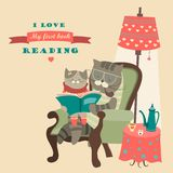 Cat and kitten reading book royalty free illustration