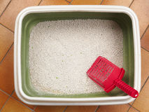 Cat litter box. Cat litter, in the box, made of little stones of clay stock photography
