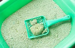 Cat litter box for toilet of a cat with green scoop. Cat litter box for toilet of cat with green scoop Stock Photography