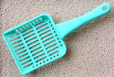 Cat Litter with cat sand scoop Royalty Free Stock Photography