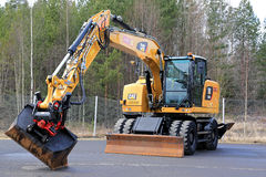 Cat M318F Wheeled Excavator on Asphalt Yard Royalty Free Stock Photos