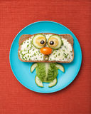 Cat made of bread and vegetables Stock Photo