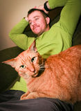 Cat and Man Relaxing Stock Images