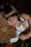 Cat nap. A cute young girl relaxing with her kitty on a sofa Stock Images
