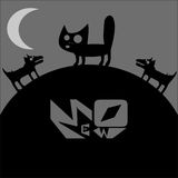 Cat in the night howling at the moon and scares the dogs Royalty Free Stock Photos